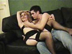 Sexy blonde milf sucking and fucking a young guy as her husband films it