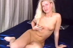 Cute young blonde with red fingernails toys