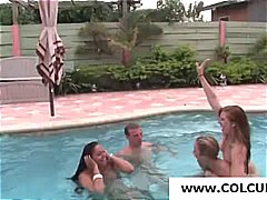 Naked coeds in the pool get out and give him a blowjob and handjob