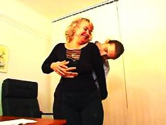 Mature secretary seduces him in the office