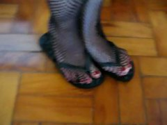 For those who like foot fetish as she is in fishnet flip flop tease