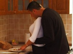 Busty blond teen gets a kitchen fuck