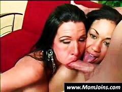 Brunette mom and daughter share a hard cock and take turns