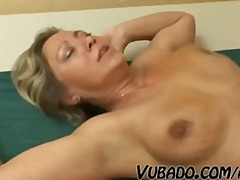 Young stud hammers this blonde granny till he cums on her snatch
