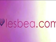 Lesbea sliding a strap-on deep inside