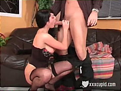 Brunette gives a blowjob on the couch