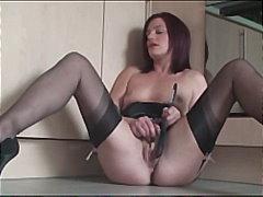 Stocking milf sticks pasting brush up her pussy