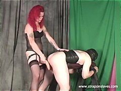Slave fucked with thick dildo