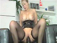 Mature riding a huge dildo!