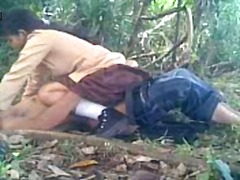Two youngsters get into a secret spot in the bushes and fuck each other