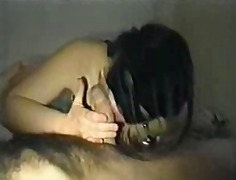 Masked woman fucks and sucks