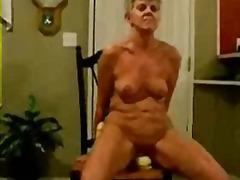 Horny granny riding a big toy