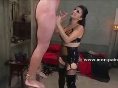 Strong man suspended with ropes by canopy tormented with wax in bondage dominatrix sex video