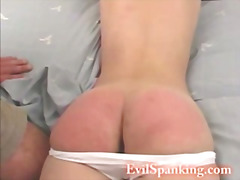 Sexy chick hand spanked on her bed