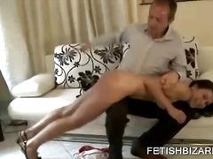 Naked chick having bottom slapped