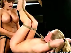 Lesbo dominatrix is pegging her sub