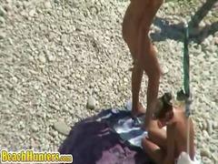 חוף מצלמות זוג עירום ריגול