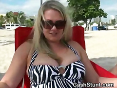 Blonde amateur flashing her big tits on a beach