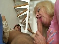 Blonde grandma sits on his oustanding rooster
