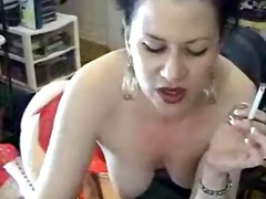 Dark haired gal onto her undies masturbating while smoking