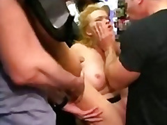 Busty bondage babe groped and fucked in public porn store full of strangers