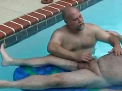 Hairy big boys jerking rods by the pool