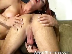 Redhead shemale mouthing our shaft