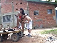 Outdoor fun for a busty tranny and her lover guy