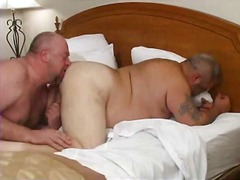 Fat gay guys on a bed