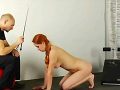 Slave redhead babe is getting trained