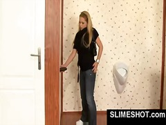 Blonde jerks of dick in gloryhole and gets sprayed with slim