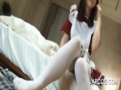 Asian maid giving her horny boss a footjob
