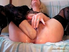 Sexy self fisting mature in black stockings