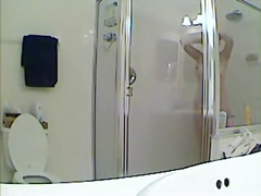 Spy cam shower vid with girl hiding body under towel