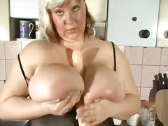 Milf with extreme big natural tits alone at home