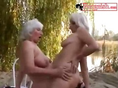 Sexy woman fuck each other by the beach