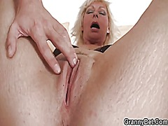 Blonde granny takes it from behind