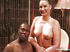 Dominant flower tucci sits on the darky man's love stick after torturing him